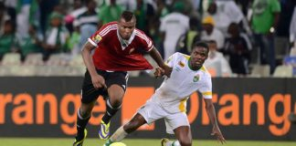 Danny Phiri of Zimbabwe battles with Abdelsalam Omar of Libya during the 2014 CAF African Nations Championships Semi Final