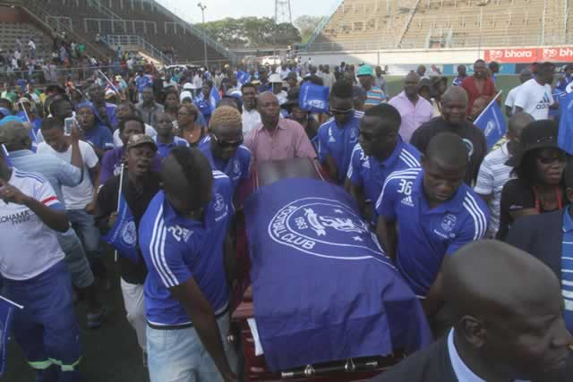 Dynamos skipper Augustine Mbara (left) and fellow defender Elisha Muroyiwa lead their teammates during the parading of Freddy Mkwesha's body at Rufaro