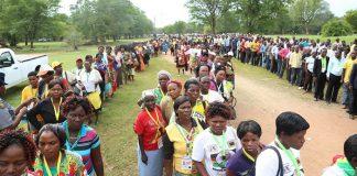 Zanu PF delegates go through security checks at the conference venue