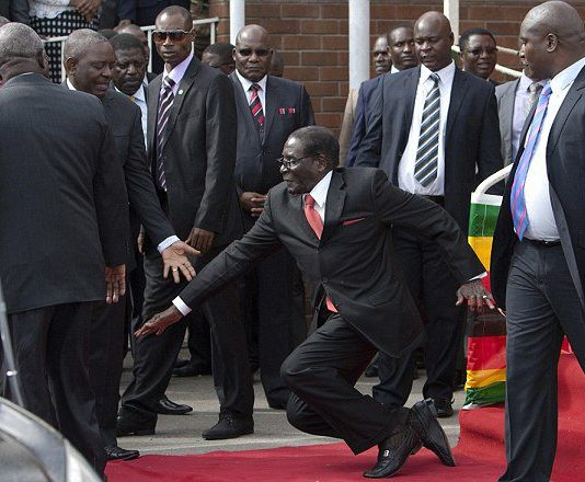 SYMBOLIC: Zimbabwe's president Robert Mugabe, 91, tripped as he came down some podium stairs at the airport last year