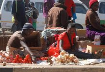 Vegetable vendors sell their wares