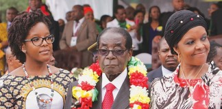 President Robert Mugabe flanked by his daughter Bona and wife Grace