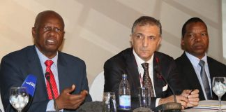 Finance and Economic Development Minister Patrick Chinamasa (left) addresses guests while IMF Head of Mission Mr Domenico Fanizza and Reserve Bank of Zimbabwe Governor Dr John Mangudya (right) look on during the wrap-up meeting and dialogue at the conclusion of the first review of the IMF Staff Monitored Programme (Picture by Innocent Makawa)