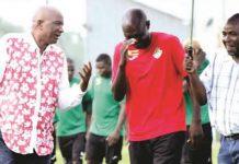 Zifa president Philip Chiyangwa shares a lighter moment with Warriors coach Callisto Pasuwa