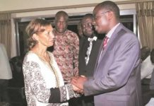 A HUGE LOSS . . . Sports and Recreation Minister Makhosini Hlongwane (right) comforts Liz Rosen, the wife of former Motor Action director Eric Rosen, after he visited the family home in Harare last night, in the company of ZIFA president Philip Chiyangwa
