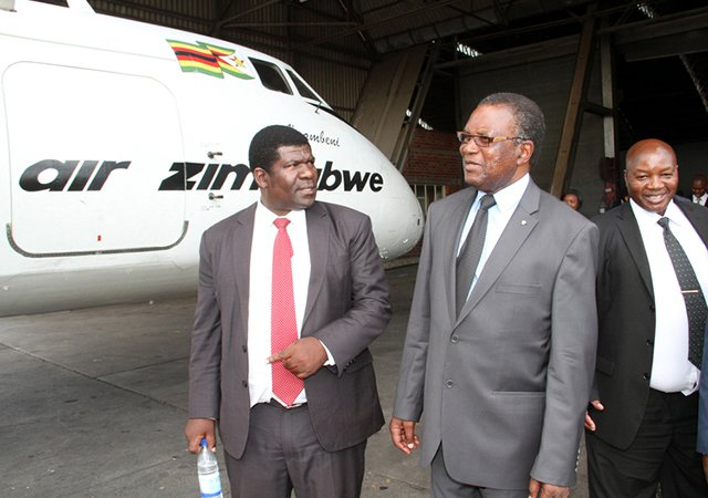Transport and Infrastructural Development Minister Dr Joram Gumbo discusses Air ZImbabwe operations with the airline's Acting CEO Mr Edmund Makona during a familiarisation tour in Harare yesterday. Looking on is Airzim Technical Operations Acting Director Mr Joseph Marowa. — (Picture by John Manzongo)