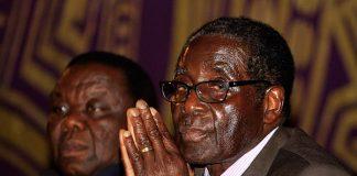 Opposition leader Morgan Tsvangirai (left) has implored President Robert Mugabe (right) to cut short his overseas holiday