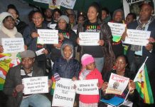 Activists from the Zimbabwe Vigil in London