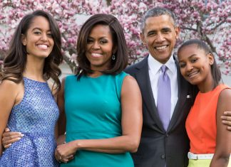 President Barack Obama, First Lady Michelle Obama, and daughters Malia and Sasha pose for a family portrait with Bo and Sunny in the Rose Garden of the White House on Easter Sunday, April 5, 2015.