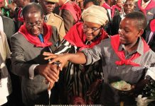 President Robert Mugabe and wife Grace seen here with their son Chatunga