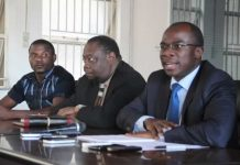 Sport and Recreation Minister Makhosini Hlongwane (right) addresses journalists at a Press conference yesterday at his offices, while Charles Manyuchi (extreme left) and the permanent secretary in the Ministry, Godfrey Chipare (centre), looks on