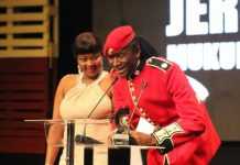 Jah Prayzah thanks his fans after scooping the Outstanding Male Musician and Outstanding Album of the Year awards while his wife looks on