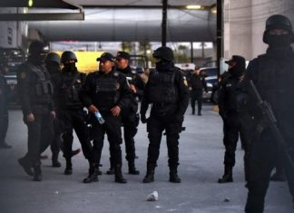 By morning, troops and heavily armed police could be seen on the prison grounds