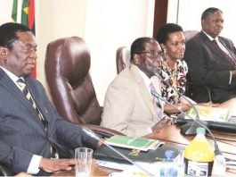 File picture of President Robert Mugabe addressing the Zanu PF politiburo while flanked by his wife and the two Vice Presidents Emmerson Mnangagwa (left) and Phelekezela Mphoko (right)