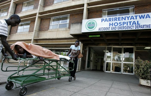 File Picture: A patient is taken home on a stretcher by his relatives from Parirenyatwa hospital's accident and emergency ward in the capital Harare August 21, 2009. REUTERS/Philimon Bulawayo (ZIMBABWE HEALTH SOCIETY POLITICS)