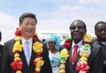 President Xi Jinping is welcomed by Zimbabwean President Robert Mugabe in Harare