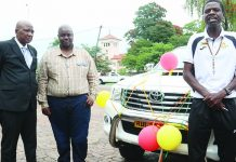 Mighty warriors coach Shadreck Mlauzi (right) speaks after being handed over keys to a Toyota Hilux, while Wicknell Chivayo (centre) and Philip Chiyangwa look on (Picture by NewsDay)