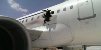A huge hole in the fuselage appeared close to the wing