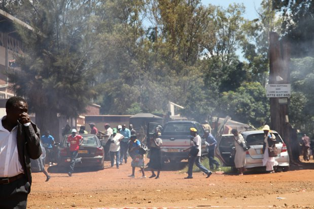 Some of the war veterans scatter after police fired teargas canisters. Pictures by Innocent Makawa