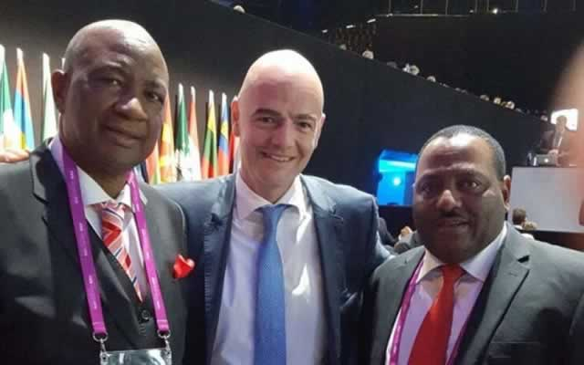 ZIFA president Philip Chiyangwa (left) poses for a picture with new FIFA president Gianni Infantino (centre) and the association's vice-president Omega Sibanda
