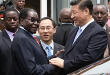Robert Mugabe shakes hands with Xi Jinping as the Chinese president arrives in Harare last year