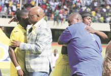 ZIFA president Philip Chiyangwa (left) and benefactor Wicknell Chivayo greet the Warriors before their battle against Swaziland at the National Sports Stadium yesterday