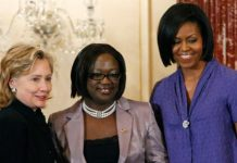First lady Michelle Obama and Secretary of State Hillary Rodham Clinton present the 2010 International Women of Courage Award to Jestina Mukoko of Zimbabwe, March 10, 2010, at the State Department in Washington.