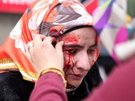 The picture, taken by Zaman, appears to show a wounded woman outside the newspaper offices on Saturday