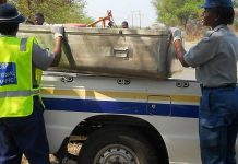 File picture of traffic police loading a metal coffin