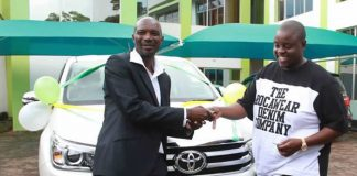 Warriors coach Callisto Pasuwa receiving his car from Wicknell Chivayo