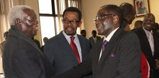 Cephas Msipa seen here with Robert Mugabe during a politburo meeting