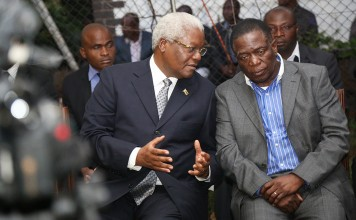 Vice President Mnangagwa converses with Minister Ignatius Chombo at the Chitepo family home in Harare this month