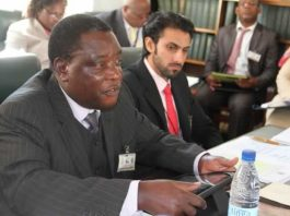 Civil Aviation Authority of Zimbabwe CEO Mr David Chawota (left) addresses the Parliamentary Portfolio