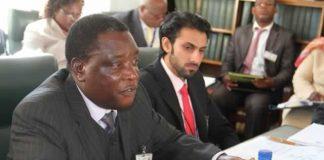 Civil Aviation Authority of Zimbabwe CEO Mr David Chawota (left) addresses the Parliamentary Portfolio