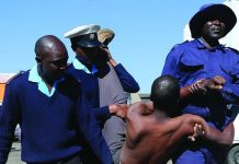 Harare municipal police arresting a vendor who was resisting removal from the Speke Avenue vending site