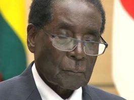Robert Mugabe sleeping on the podium in Japan