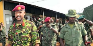 Kainerugaba Muhoozi, on the left, is seen as the most powerful person in the army