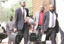 Munyaradzi Kereke (right) arrives for his trial at the Harare Magistrates courts
