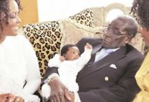 President Mugabe cradles his grandson, Simbanashe Chikore, in Singapore at the weekend while First Lady Amai Grace Mugabe and proud mother Bona (partly obscured, right) look on. (Picture by Presidential photographer Joseph Nyadzayo.