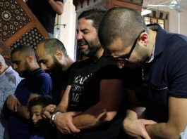 Relatives of the victims of the missing EgyptAir flight MS804 hold an absentee funeral prayer
