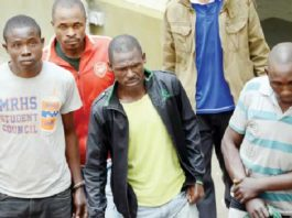The four men held on suspicion of killing Shingai Dhliwayo after their court appearance in Bulawayo yesterday