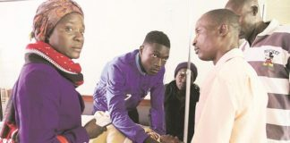 Distraught friends and relatives visited injured Dynamos fans admitted at Parirenyatwa Group of Hospitals in Harare yesterday. Here, midfielder King Nasama (in blue jacket) holds a phone for his mother Ms Shylet Tinonetsana in her bed. Ms Tinonetsana was among Dynamos fans who were involved in an accident near Battlefields about 20km outside Kadoma on Saturday. — (Picture by Tawanda Mudimu)