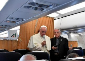 Pope Francis, flanked by Vatican spokesman Federico Lombardi, addressed journalists on the flight back from Armenia