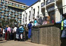 Zimbabweans queue at banks