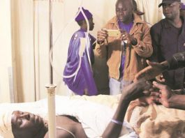 WHAT A TRAGEDY . . . Dynamos fan, Galelio Tinashe Muchemwa, greets fellow supporters from his hospital bed at Parirenyatwa Hospital on Sunday just a day before he succumbed to his injuries yesterday