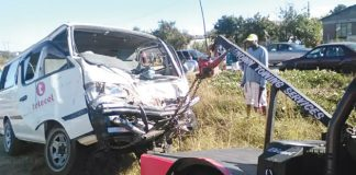 One of the kombis which was involved in the collision is toured away from the scene of the accident in Mambo suburb, Gweru, yesterday