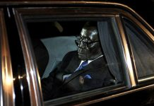 President Robert Mugabe inside his armour-plated motorcade vehicle