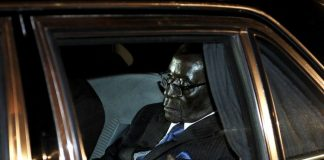 President Robert Mugabe inside his armour-plated motorcade vehicle