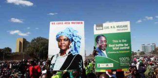 """Youths from the ruling ZANU-PF party hold portraits of President Robert Mugabe and his wife Grace during the """"One Million Man March"""", a show of support of Mugabe's rule in Harare, Zimbabwe, May 25,2016. REUTERS/Philimon Bulawayo."""