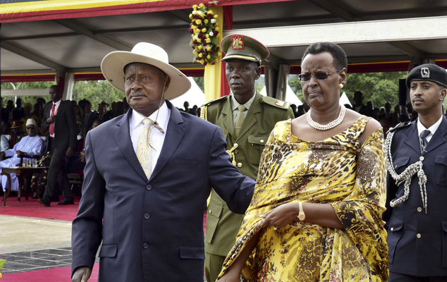 Uganda's long-time president Yoweri Museveni, 71, left, and his wife Janet Museveni, right, attend his inauguration ceremony in the capital Kampala, Uganda Thursday, May 12, 2016. Museveni was sworn in for a fifth term taking him into his fourth decade in power, amid arrests of opposition politicians and a shutdown of social media. (AP Photo/Stephen Wandera)